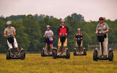 Guide leading 4 people on a Segway tour