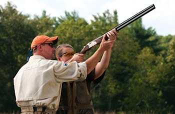 two men with a shotgun