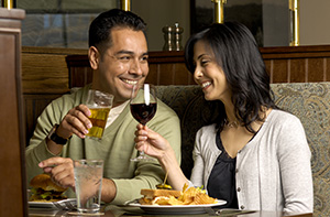 couple enjoying a meal with wine pairing at Cedric's Tavern