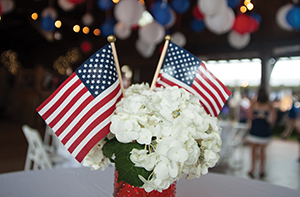 table decorated in red white and blue for memorial day