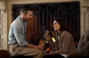 man and woman enjoying fire at Inn fireplace