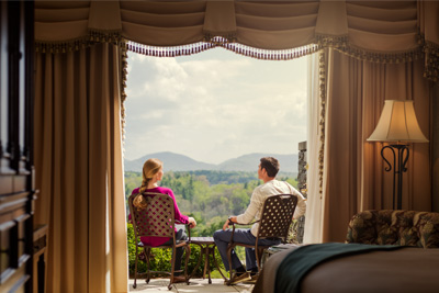 couple on balcony - The Dining Room Biltmore Estate
