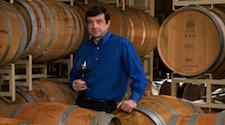 Bernard Delille standing around barrels