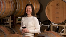 Sharon Fenchak in front of wine barrels