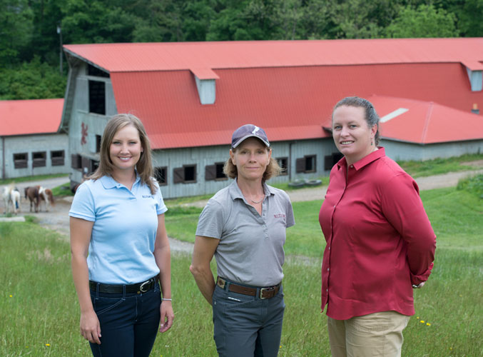 3 women equestrian workers