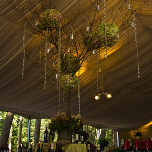 Centerpiece set up in a tent for an event