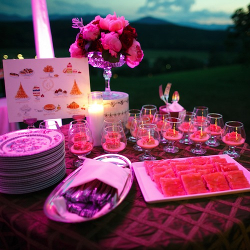 Table set up for an event lit in pink