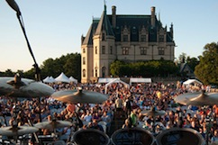a large gathering of people on lawn of the Biltmore House