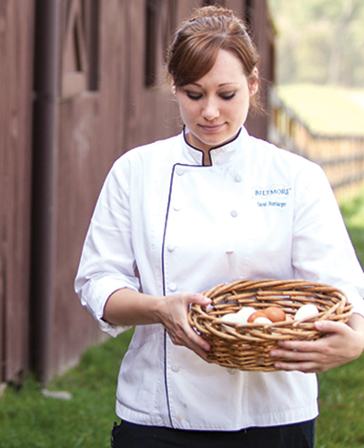 chef holds basket of fresh eggs on the estate