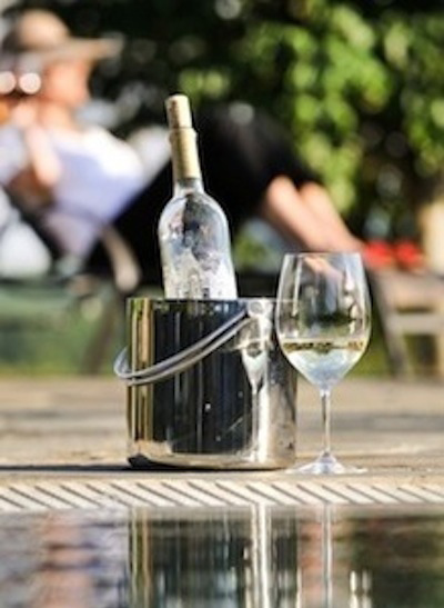 chilled bottle of wine with glass