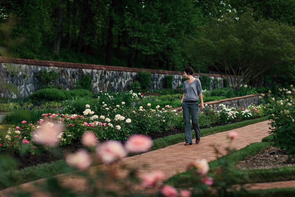 Man walking through the gardens