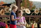 Play with toys and games from the 1800s like hoop rolling.