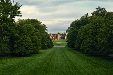 Looking down a long field leading to the Biltmore House