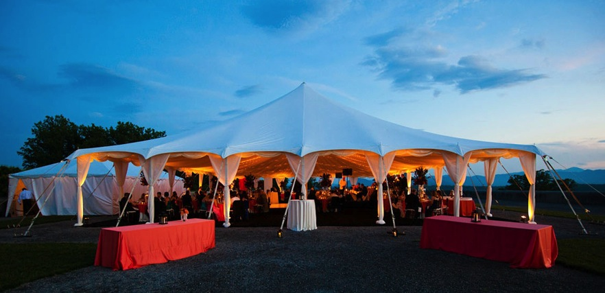 Tent lit up at night for an event
