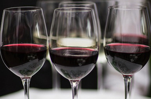 trio of glasses of red wine