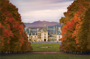Biltmore House seen from atop Diana's hill, surrounded by colorful fall foliage