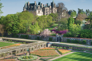 spring image of biltmore house seen from walled garden in bloom
