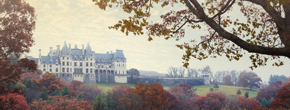 Biltmore House seen from a distance with trees in fall colors surrounding