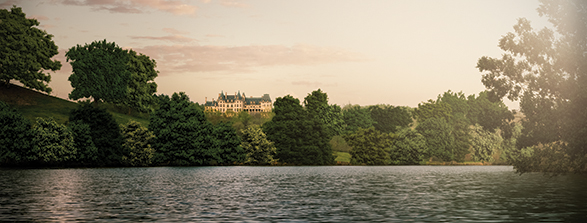wide view of Biltmore House up on a hill from the Lagoon