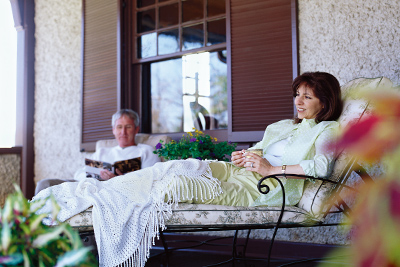 couple lounging on the back porch of the Cottage on Biltmore Estate
