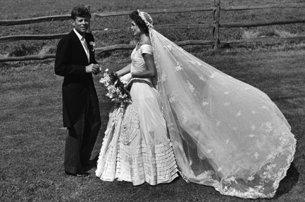 John and Jackie Kennedy at their wedding wearing the family veil