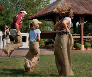 Family in a potato sack race