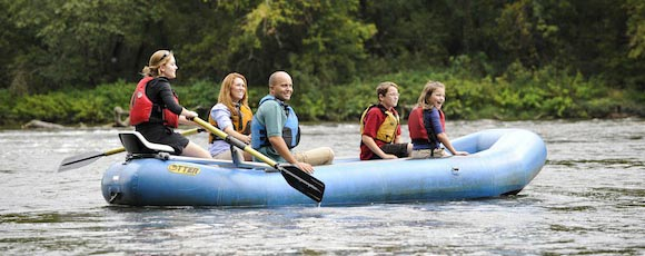 family on a rafting trip
