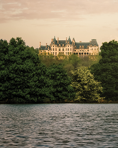 Biltmore House up on a hill as seen from the lagoon