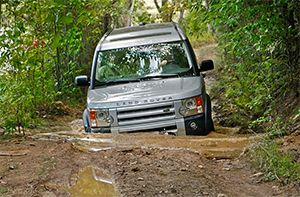 land rover driving on rugged trail