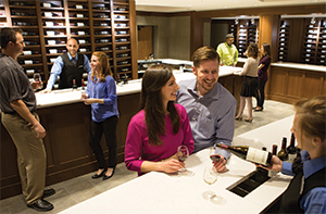people tasting wine at the wine bar