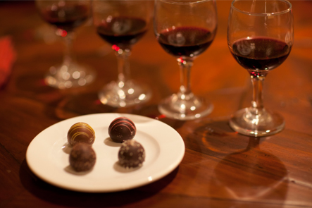 glasses of red wine with chocolates