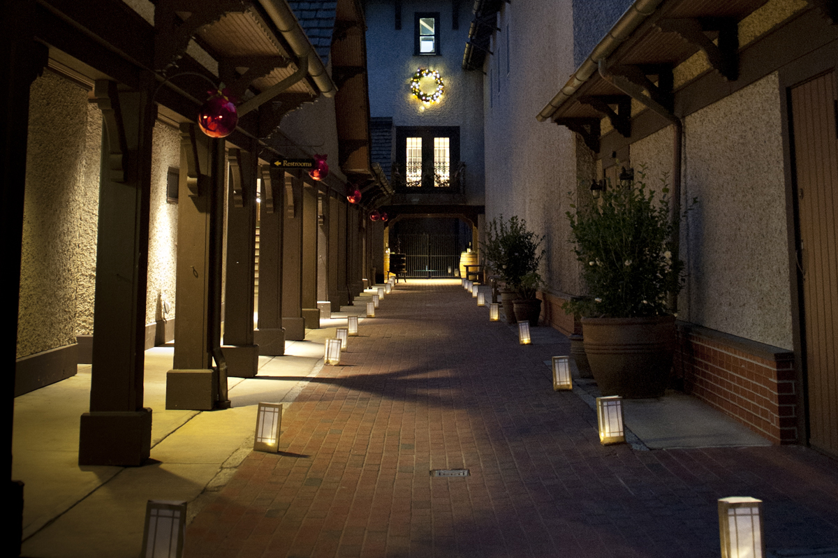Outside the winery at night looking towards the clock tower with glowing luminaria