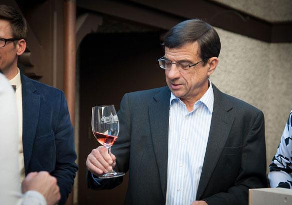 Biltmore winemaker Bernard Delille with a glass of wine