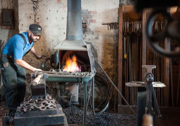 Biltmore blacksmith at work in his shop at Antler Hill Barn