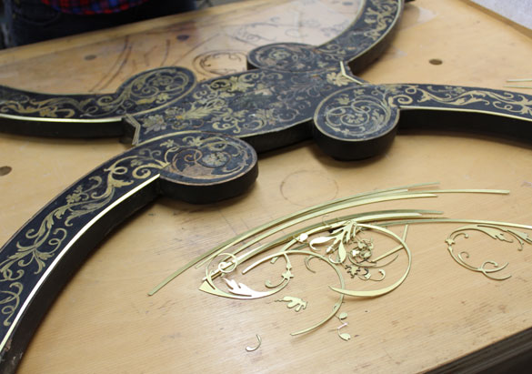 New brass marquetry shapes cut to fit the original desk