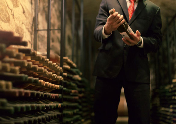 Chooseing a bottle from Biltmore's wine cellar