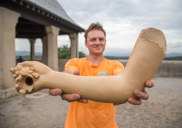 Asheville artist with sculptural limb at Biltmore