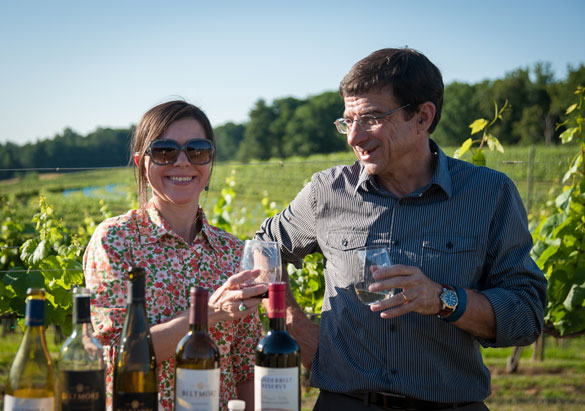 Biltmore winemakers Sharon Fenchak and Bernard Delille enjoy a glass of wine in the vineyard