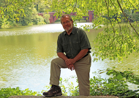 Bill Alexander with Biltmore's Bass Pond bridge behind him