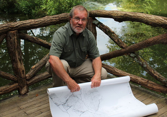 Bill Alexander unrolls a copy of Frederick Law Olmsted's map