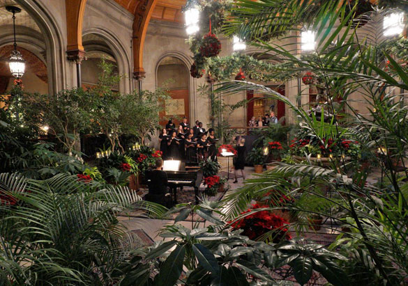 Choirs perform in the Winter Garden during Candlelight Christmas Evenings at Biltmore