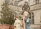 A house party in December of 1898 included this assembly of merry guests: George Vanderbilt's close friend, William B. Osgood Field (seated atop the lion sculpture), along with guests Mary Field (left) and Mary Hellen Cadwalader (right).