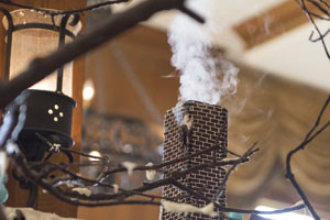 Cinnamon-scented smoke coming out of the gingerbread chimney