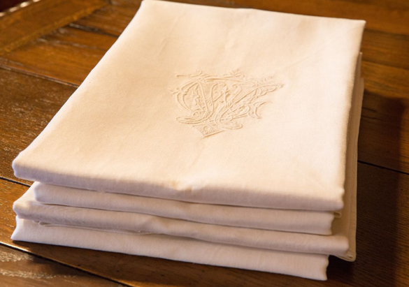 White napkins in the Biltmore House collection featuring George Vanderbilt's monogram