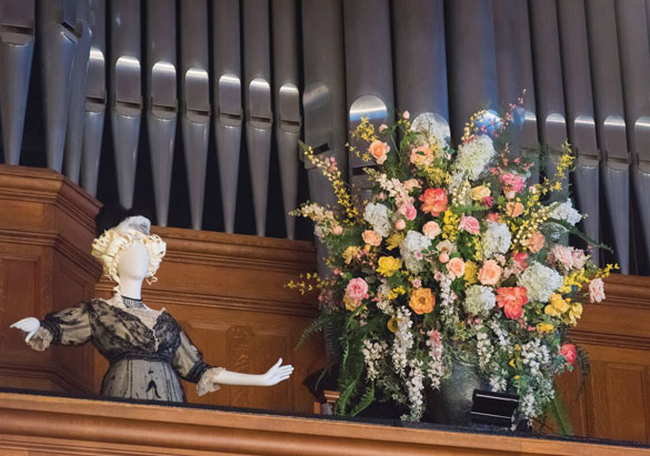 Opera singer mannequin and floral arrangement in Biltmore House Organ Loft