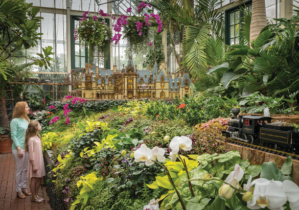 Guests enjoy Biltmore Gardens Railway in the Conservatory