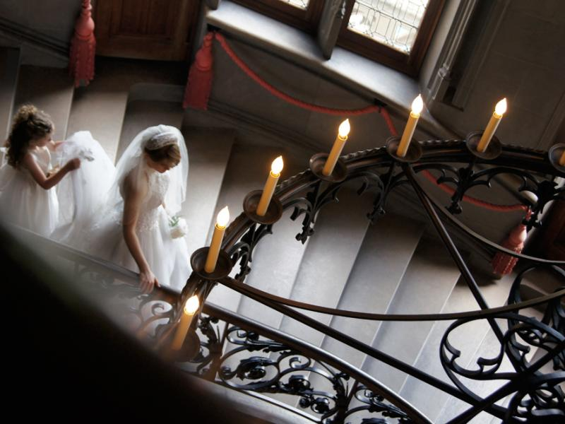 bride and flower girl walking down the stairs
