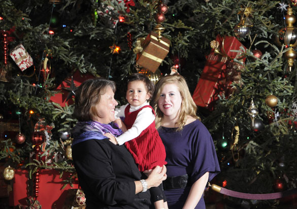 A family enjoys Biltmore's Christmas party