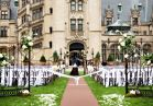Imagine walking down the aisle on the Front Lawn of Biltmore house in this photo by Woodward and Rick Photographers.