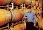Winemaker Bernard Delille tastes the aging wine to see if it's ready for bottling.